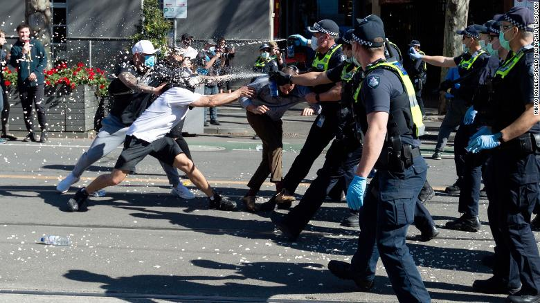 Australia suffers its worst day of Covid-19 pandemic as anti-lockdown protests flare 2021