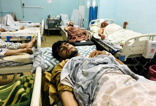 New urgency to airlift from Kabul after blasts kill dozens