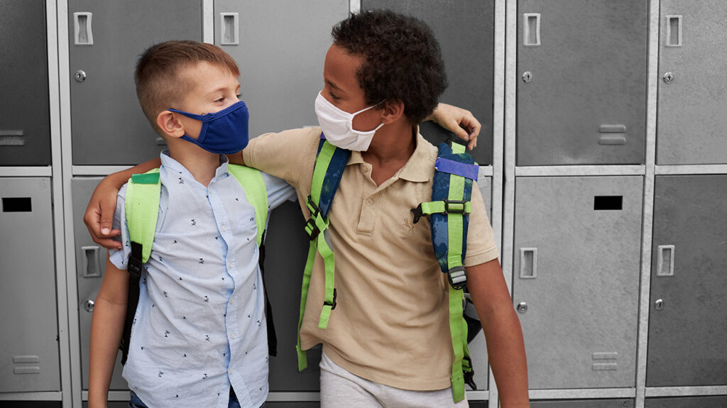 How can we prevent the spread of SARS-CoV-2 in children?