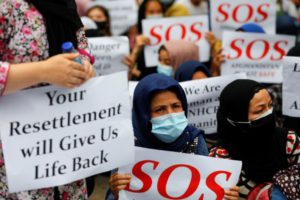 Afghan refugees holding placards ask for justice and resettlement during a rally outside the UN Refugee Agency UNHCR's office in Jakarta, Indonesia, August 24, 2021